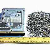 A hard disk drive, before and after shredding.