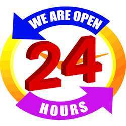 A We Are Open 24 Hours sign.