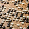 Google Reveals Secret Test of AI Bot to Beat Top Go Players