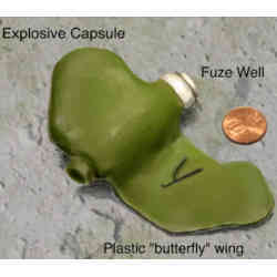 Rendering of an inert PFM-1 plastic landmine (butterfly mine) with a U.S. coin for scale.