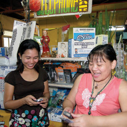 Salon owner Josephine Macaladad with Merlita Werlan at the Balayan Public Market in Batangas, Philippines