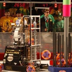 students and their robots at the FIRST competition