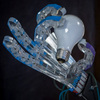 Low Cost, Dexterous Robotic Hand Operated By Compressed Air