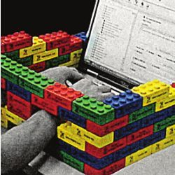 laptop typist's hands constrained by Lego