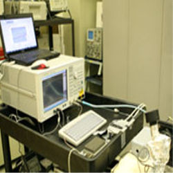 Experimental system transfers data at one gigabit per second. Infrared laser (black device on right) transmits the data.