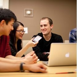 Harvard seniors, from left, Winston Yan, Joy Ding, and Alex Bick discuss plans for their Rover iPhone app.