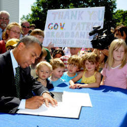 Massachusetts Governor Deval Patrick signing legislation