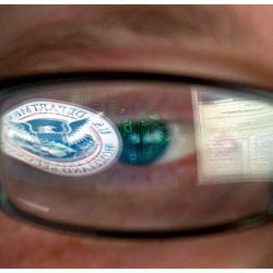 DHS logo reflected in an analyst's eyeglasses