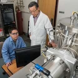 Researchers working with technology used in spintronics research.