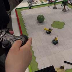 Playing a board game with a video game controller.