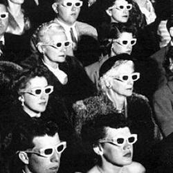 A movie audience wearing 3D glasses.