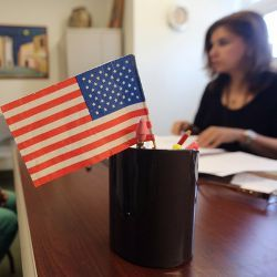 American flag on business desk