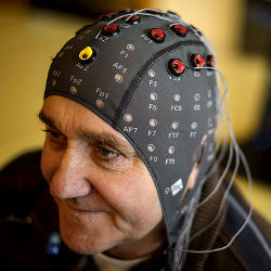 patient wearing cap with electrodes