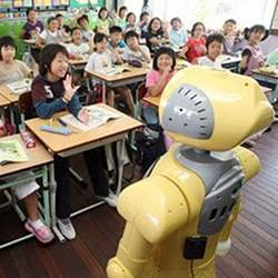 A robot teacher in front of a class.