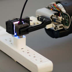 Armed with the GelSight sensor, a robot can grasp a freely hanging USB cable and plug it into a USB port.
