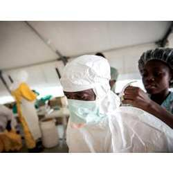An aid worker prepares to deal with an Ebola-infected patient.