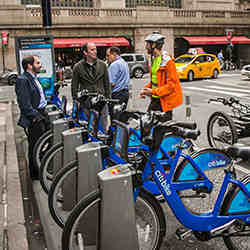 "Cornell University professor David Shmoys, left, and graduate student Eoin O'Mahony discuss ""rebalancing"" with Citi Bike worker Kelly McGowan in New York City."