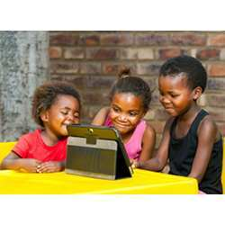 South African students interact with a computing device.