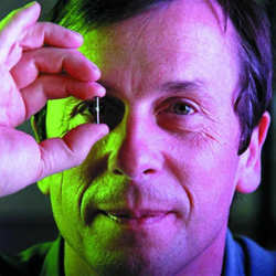 Kevin Warwick, a professor of cybernetics at Coventry University, shows an RFID transmitter like the one what was implanted in his arm in 1998.