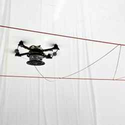 Equipped with spools of rope, the drones can autonomously build a rope structure.