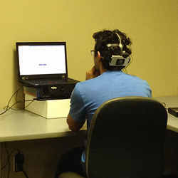 The research team set up an EEG headset for measurement of brain signals.