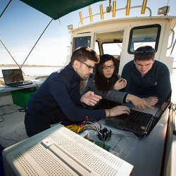 State University of New York at Buffalo students working on underwater wireless technology at Lake Erie, just south of Buffalo, NY.