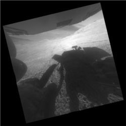 Opportunity rover shadow and tracks on Mars