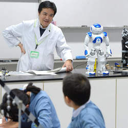 A humanoid robot equipped with an artificial intelligence helps a teacher with a science class at Keio University Kindergarten in Shibuya Ward, Tokyo, Japan.