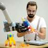 Robot Learns to Play With Lego by Watching Human Teachers