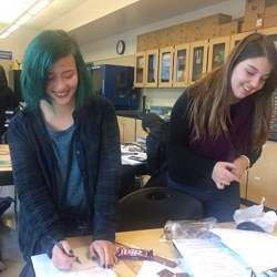 Girls at Dublin High School's engineering academy conduct an experiment about weight and density.