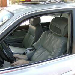 A driver disguised as an empty car seat.