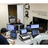 Software coders work at the Bit Source office in Pikeville, Ky.