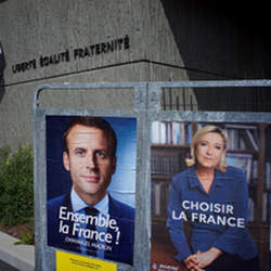 Posters for Emmanuel Macron and Marine Le Pen in advance of Frances presidential runoff election.