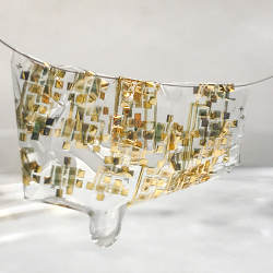 The new flexible, biodegradable semiconductor shown on a human hair.