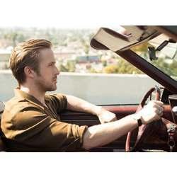 A human driver (Ryan Gosling in the film La La Land).