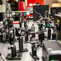 The ultrafast laser shoots very short light pulses 80 million times a second at the hybrid perovskite material.