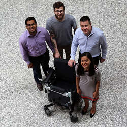 Members of the research team that developed a system to make electric wheelchairs partly or fully autonomous.
