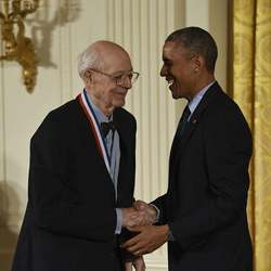 U.S. President Barack Obama congratulating Charles Bachman on his National Medal of Technology and Innovation in 2014.