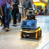 Robot Rolls With the Rules of Pedestrian Conduct