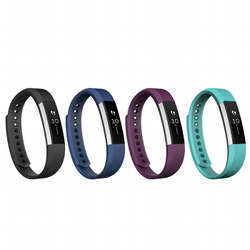 Several Fitbit wearable activity trackers.