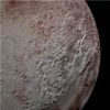 Gigantic Ice Spikes on Pluto Trace Climate