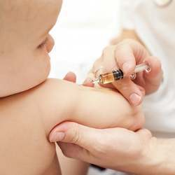 A baby being vaccinated.