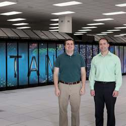 Oak Ridge researchers Steven Young (left) and Travis Johnston with the Titan supercomputer.