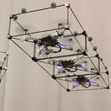 ModQuad drones that dock in mid-air.
