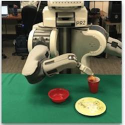 A robot that has watched a pick-and-place activity then performs the same action.