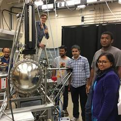 University of Central Florida assistant professor Madhab Neupane (in blue plaid shirt) with his team of student researchers.
