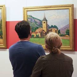 Visitors admire a painting in France's tienne Terrus Museum, where more than half of the paintings were found to be fakes.