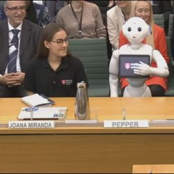 Pepper the robot before Parliament