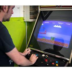 A gamer playing Super Mario.