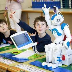 A robot in a class with human students.